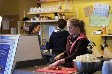 Students busy prepping food at Agora