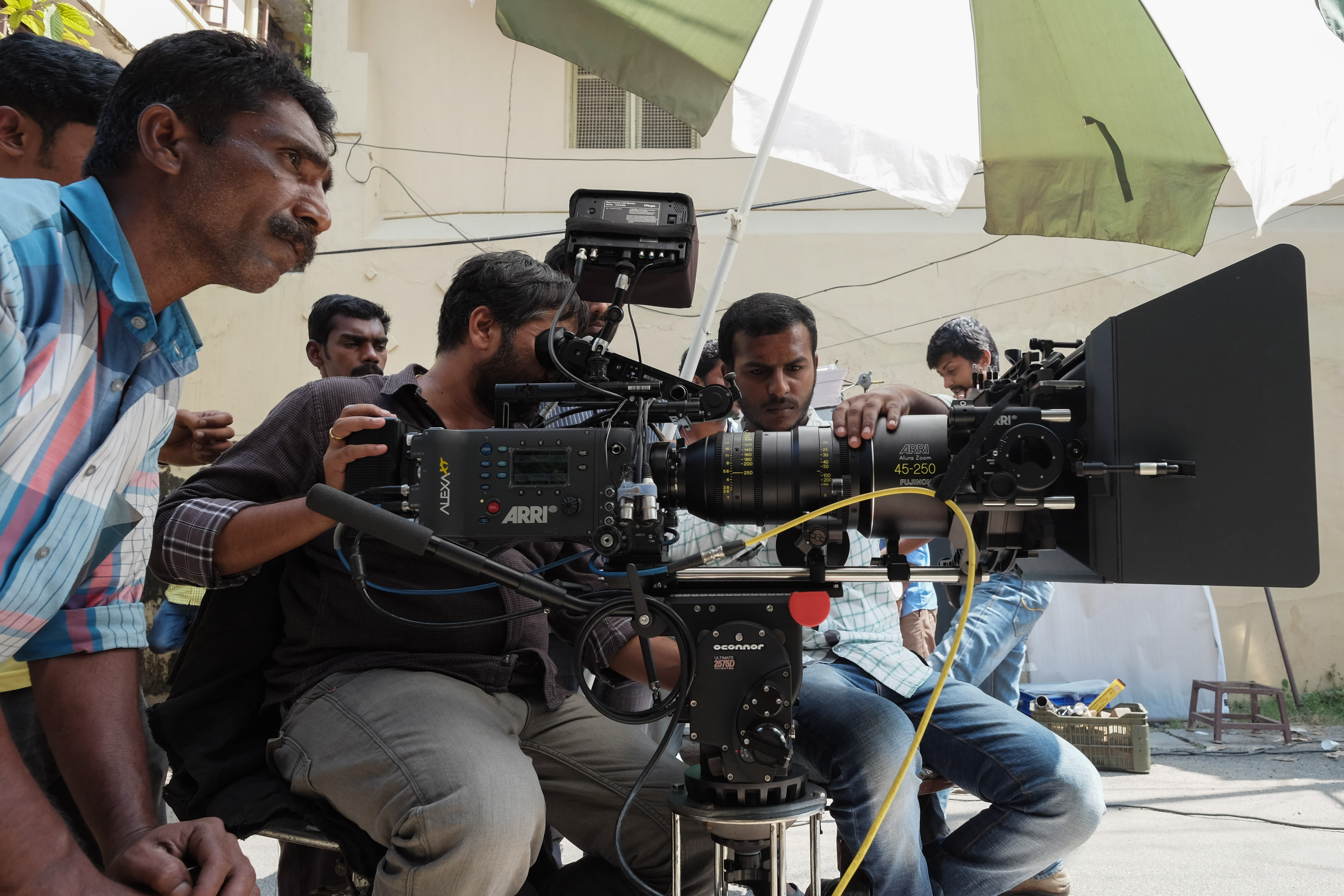 Film Crew looking towards scene with large camera