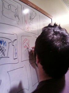 Student drawing a storyboard on a whiteboard