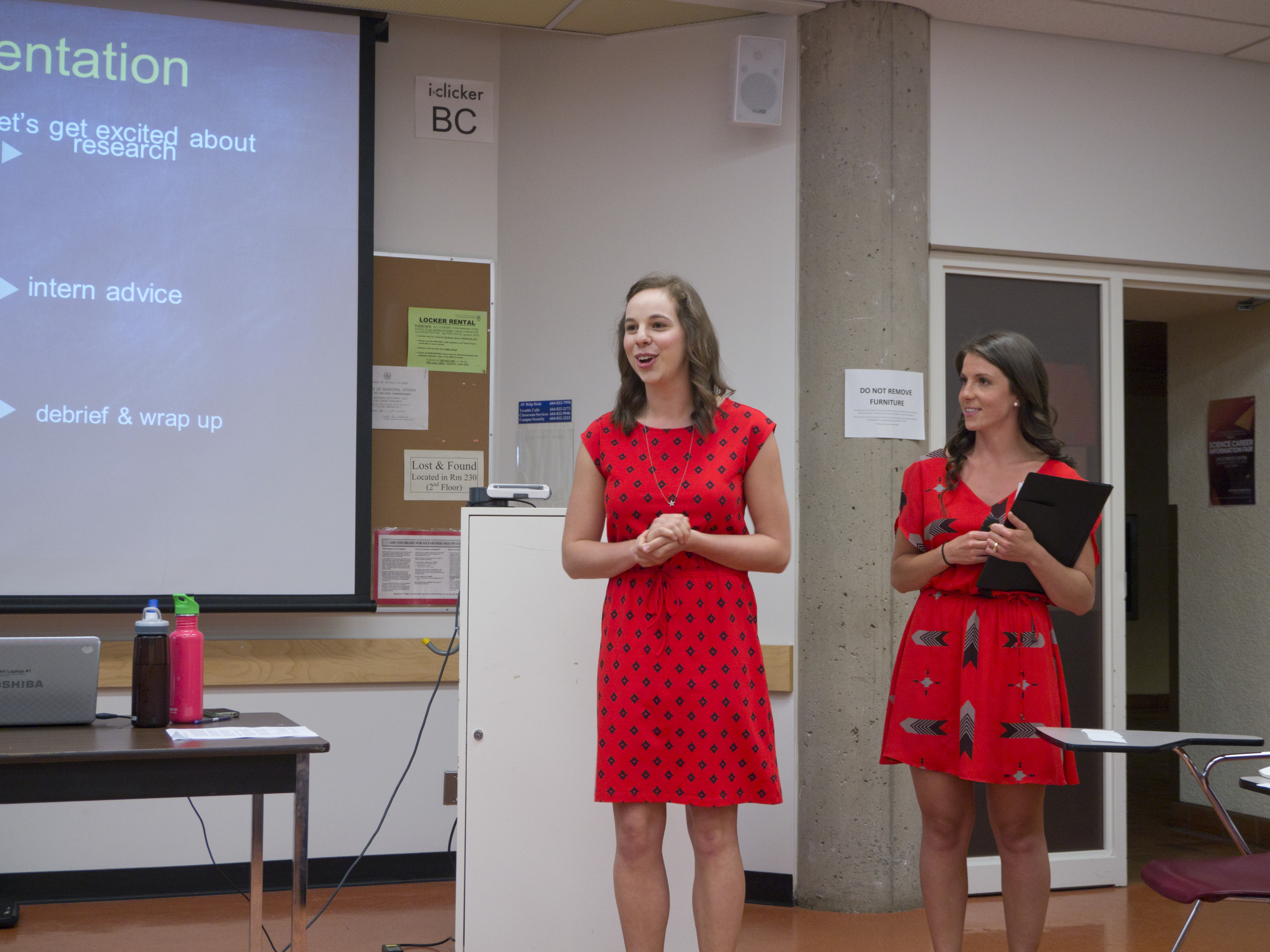 Two students running a presentation